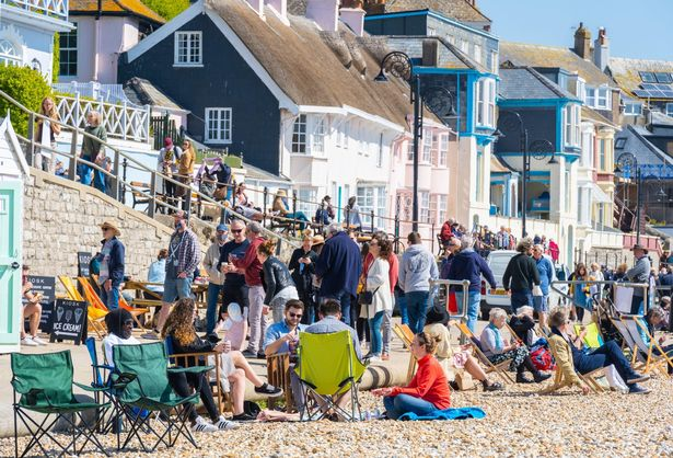 Crowds flocked to the seaside resort of Lyme Regis in Dorset to soak up the warm sunshine and bright blue skies