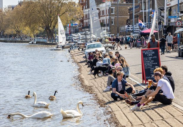 Londoners enjoy the sunshine along the River Thames in Putney