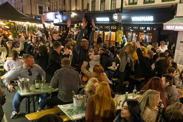 Pub-goers crowded into Soho, central London, last night after a day of incredible weather