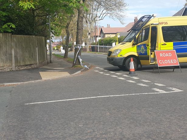 Police at the scene in Upton, Merseyside