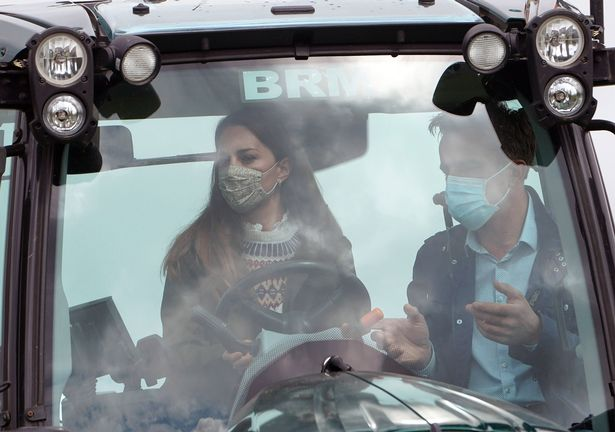 Farmer Stewart Chapman gives the Duchess of Cambridge instructions on how to drive a tractor
