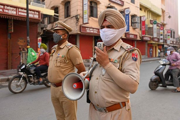 Police can be see urging the shopkeepers to close the shops before a night curfew begins after the state government's directive to curb the spread of Covid-19 coronavirus in Amritsar