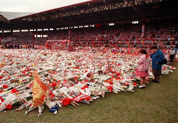In this file photo taken in 1989 thousands of flowers, wreaths and tributes are displayed on the Anfield stadium pitch in memory of the 96 soccer fans who died