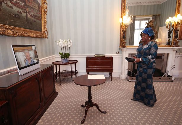 The Queen speaks to Her Excellency Sara Affoue Amani, the Ambassador of Cote d'Ivoire
