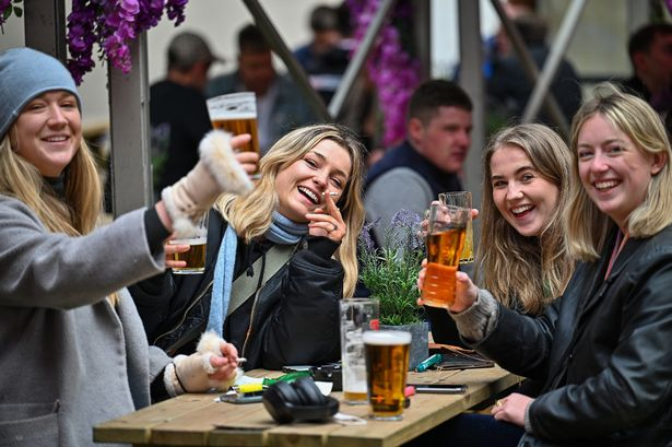 Members of the public enjoy a drink at the Three Sisters Pub in the Cowgate as lockdown measures are eased in Scotland