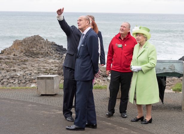 The royal couple are escorted by Bob Brown from the National Trust of Northern Ireland and guide Neville Mconachie