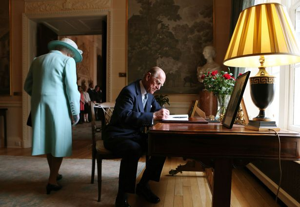 Prince Philip signs the visitors book at Hillsborough Castle