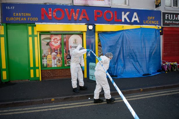 Forensic officers enter a shop on Waterloo Road, Smethwick, after a murder investigation has been launched when a teenager was chased into a shop and stabbed