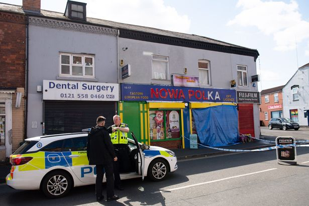 Police outside a shop on Waterloo Road, Smethwick, after a murder investigation has been launched when a teenager was chased into a shop and stabbed