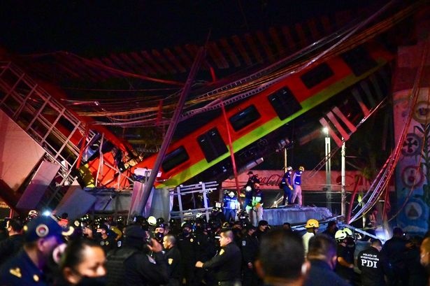 Rescue workers gather at the site of a metro train accident