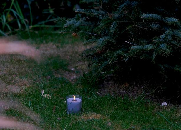 Family members and neighbours placed candles outside their homes to remember Julia James