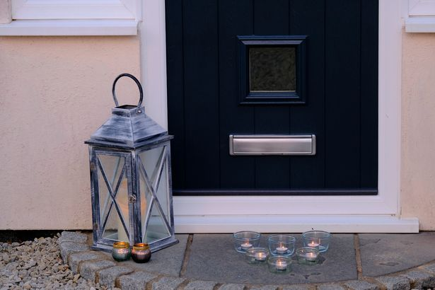 Candles have been placed outside homes to remember the PCSO