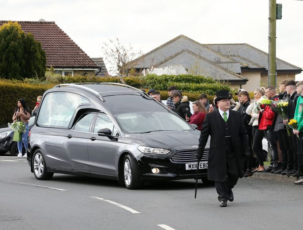 Mourners gather as Jamie McKitten's funeral procession passes through Great Lumley in County Durham
