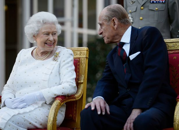 The Queen and Duke pictured at a garden party in Paris