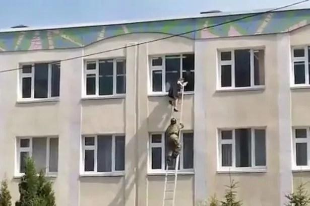 People escape a school shooting in Kazan