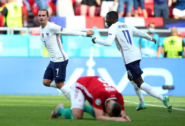 Griezmann celebrating with international team-mate Ousmane Dembele