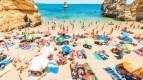 https://i0.wp.com/i2-prod.mirror.co.uk/incoming/article24684161.ece/ALTERNATES/n615/1_Bathers-on-Camilo-Beach-Lagos-Portugal.jpg?resize=143%2C80&ssl=1