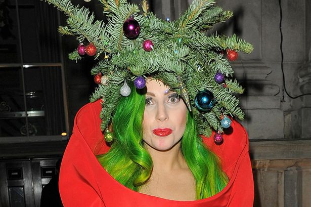 Lady Gaga Wears A Christmas Tree With A Star And Baubles