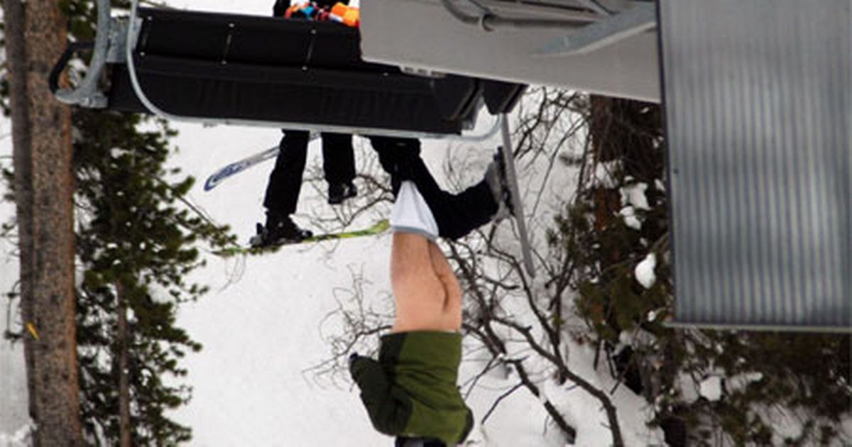 Naked skier caught with his pants down after chairlift