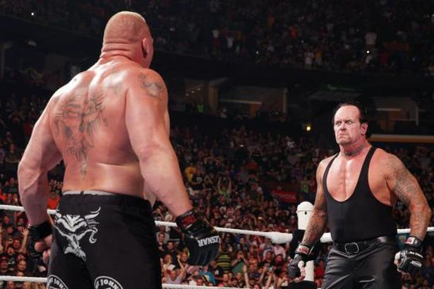 Brock Takes Undertaker Out Lesnar
