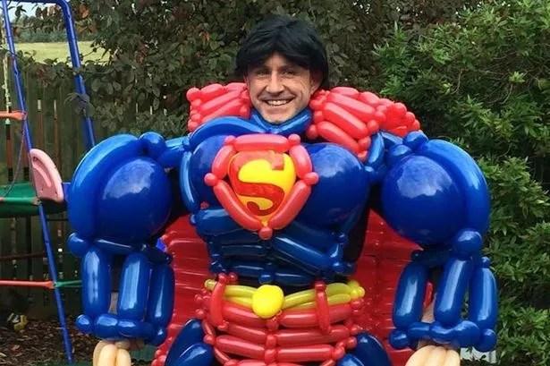 man makes giant superheroes
