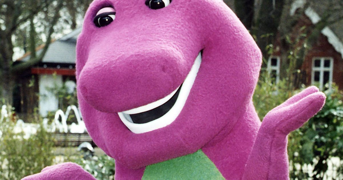 Teen tries to scare her friends wearing giant Barney head