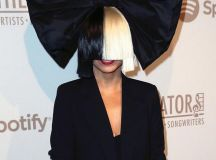 Sia reveals her wig-less FACE as she poses up a storm with ...