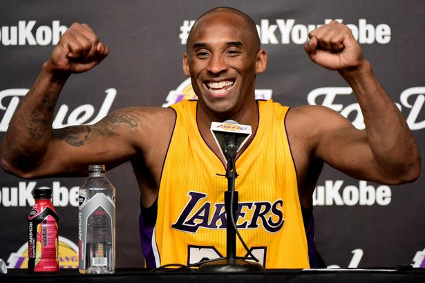 Kobe Bryant smiles during the post game news conference after scoring 60 points in the final game of his NBA career at Staples Center on April 13, 2016