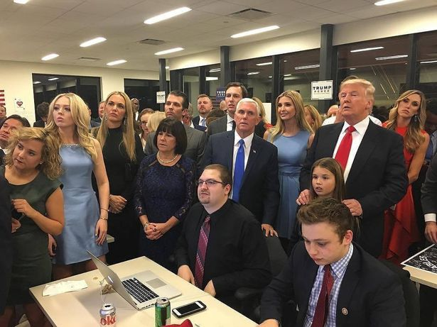 US presidential candidate Donald Trump (standing, right) watches election results with family and supporters