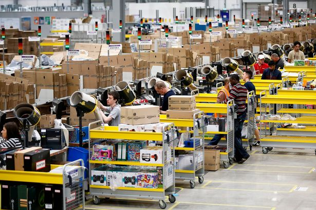 Workers at an Amazon fulfilment centre