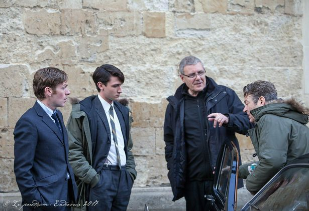Lewis Peek discusses a scene with actors and crew on location in Oxford