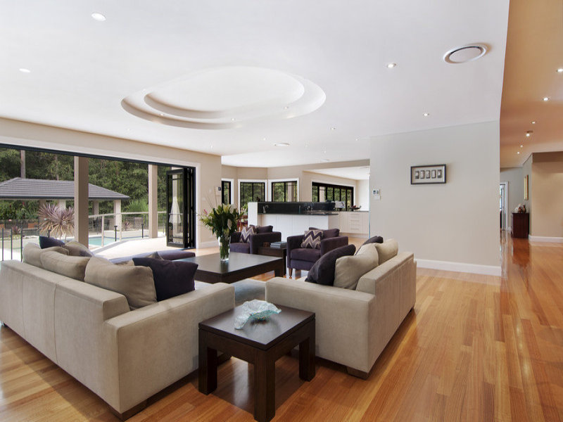 Open plan living room using white colours with hardwood  exposed eaves  Living Area photo 108812