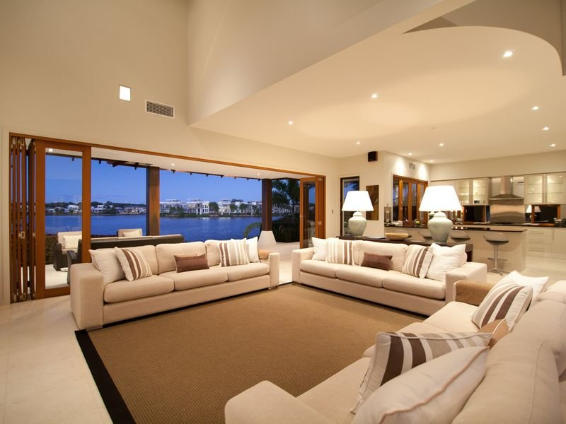Open plan living room using brown colours with carpet  french doors  Living Area photo 467069