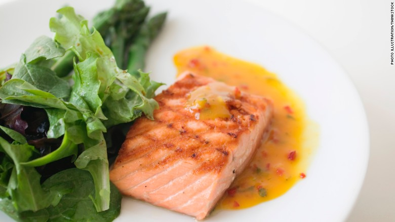 """""""Fatty fish, such as salmon and tuna, contain omega-3 fatty acids, which help control inflammation in your body,"""" dietitian Maxine Yeung says."""