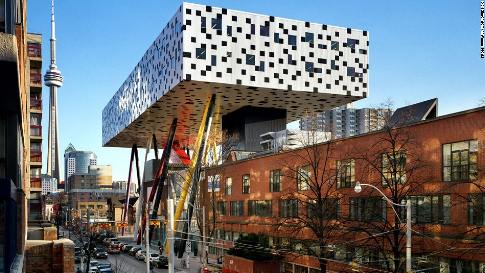 """Why build a regular school when you can make a stunning one? Architect <a href=""""http://www.all-worldwide.com/who/us/?id=1348"""" target=""""_blank"""">Will Aslop</a> answered that thought with the fun and colorful Sharp Centre for the Ontario College of Art and Design in Toronto, which balances on thin stilts."""