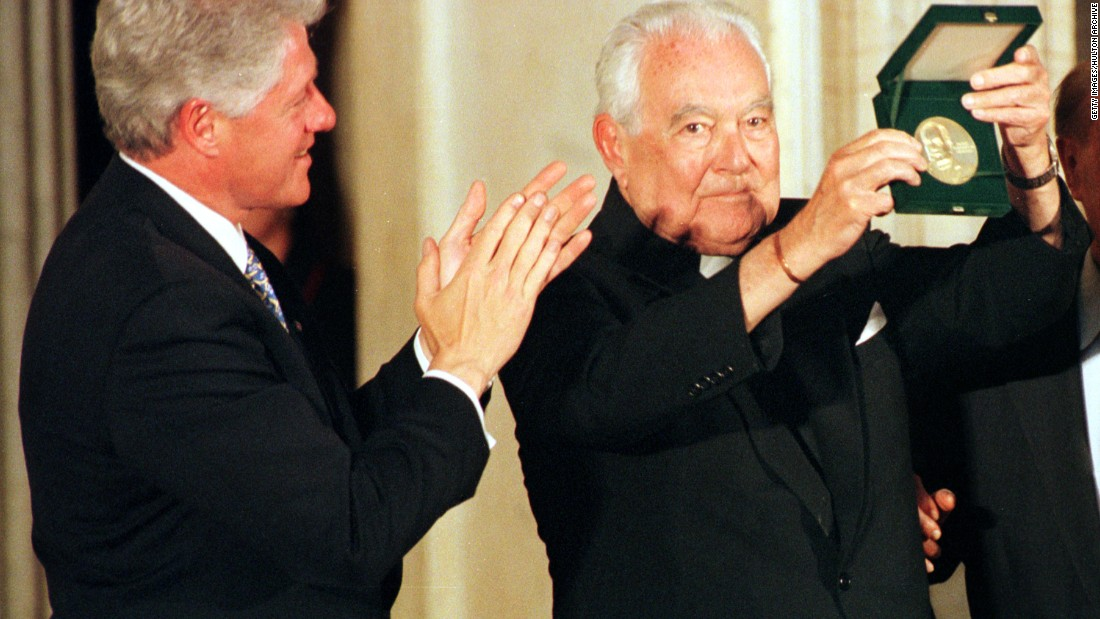 Father Theodore Hesburgh receives the Congressional Gold Medal in 2000.