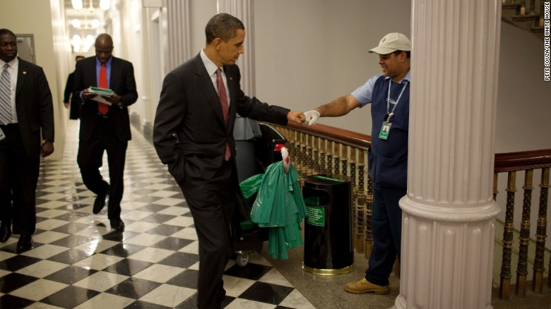 President Obama fist-bumps custodian Lawrence Lipscomb in the Eisenhower Executive Office Building. December, 2009.
