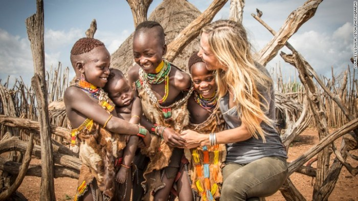 """The children are always the easiest to photograph as they love to touch, laugh and joke with me, says Seton. ""These children were fascinated with my long blond hair and loved to touch it."""