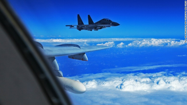 Chinese fighter flies inverted over US Air Force jet – To Inform is