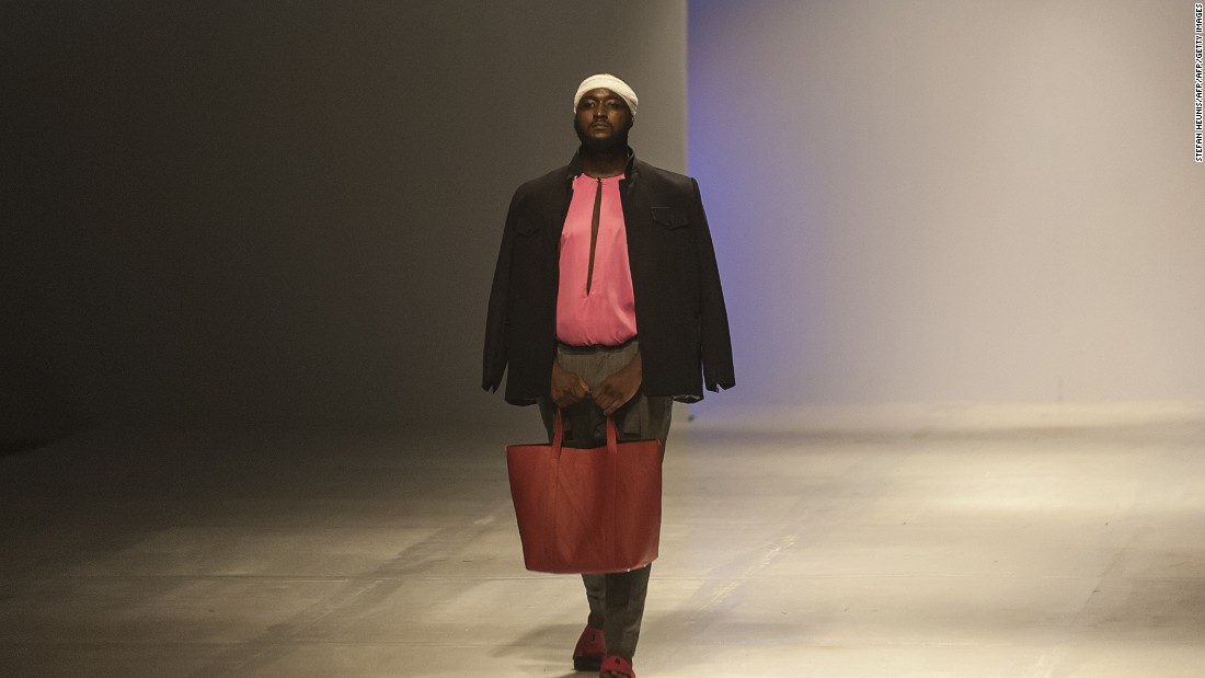 """We're trying to start a conversation, we're getting a foot in the door. People have to see plus fashion in a way they never have before.""<br />Pictured: A male model shows off some of the new collection from ÀSSIÀN by fashion designer Matiu Gordun. Photo: Stefan Heunis/AFP/Getty Images"