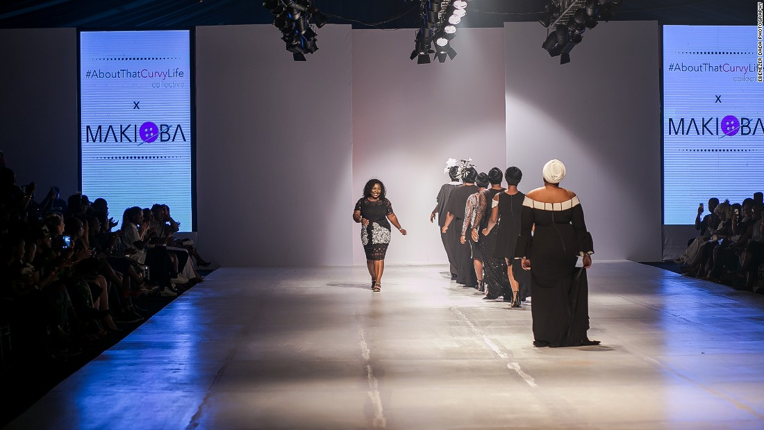 """As the first model took to the runway the crowd brought the house down. Ngwube snuck into the crowd to watch the crowd standing, screaming and clapping. """"I was shaking and crying in the crowd, I couldn't contain it.""""<br />Pictured: Designer Makioba Olugbile greets a cheering crowd."""