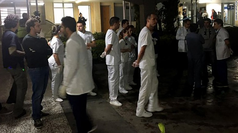 Medical staff members wait for survivors of the crashed plane Tuesday at a hospital near Medellin.