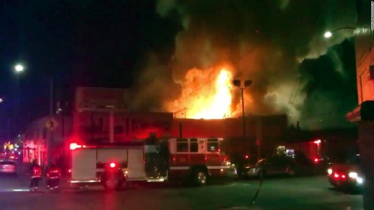 """The scene as firefighters battle the blaze from video footage by <a href=""""https://twitter.com/OaklandFireLive"""" target=""""_blank"""">@Oaklandfirelive</a> early Saturday, December 3."""