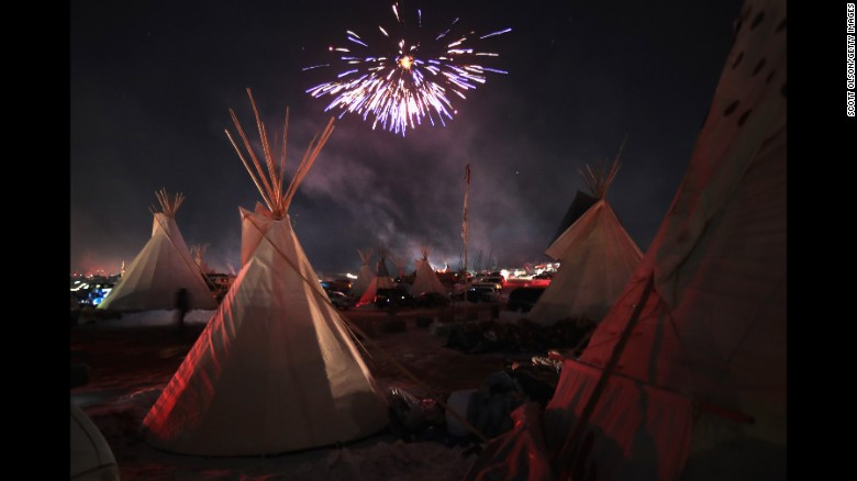 Fireworks lit the sky at the Oceti Sakowin Camp  near Cannon Ball, North Dakota on December 4, 2016, after the Army Corps of Engineers halted the Dakota Access Pipeline route. An executive order by President Donald Trump in January allowed work to resume.