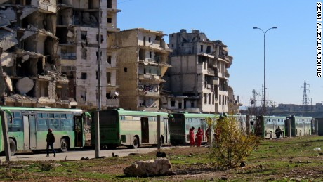 Buses used to evacuate people from rebel-held areas of Aleppo are seen waiting on Thursday.