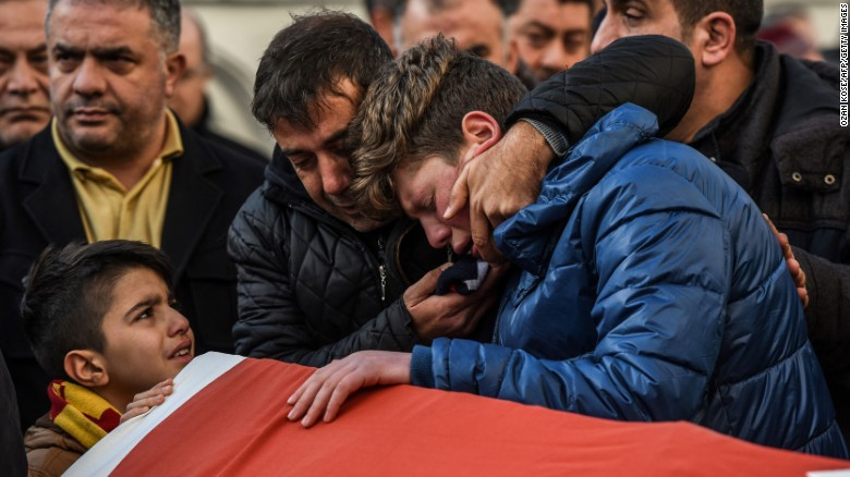 Relatives of one of the victims of the Reina nightclub attack mourn at his funeral on January 1.