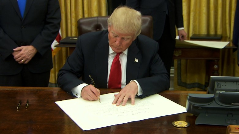 Image result for TRUMP SIGNING ORDER PICTURE