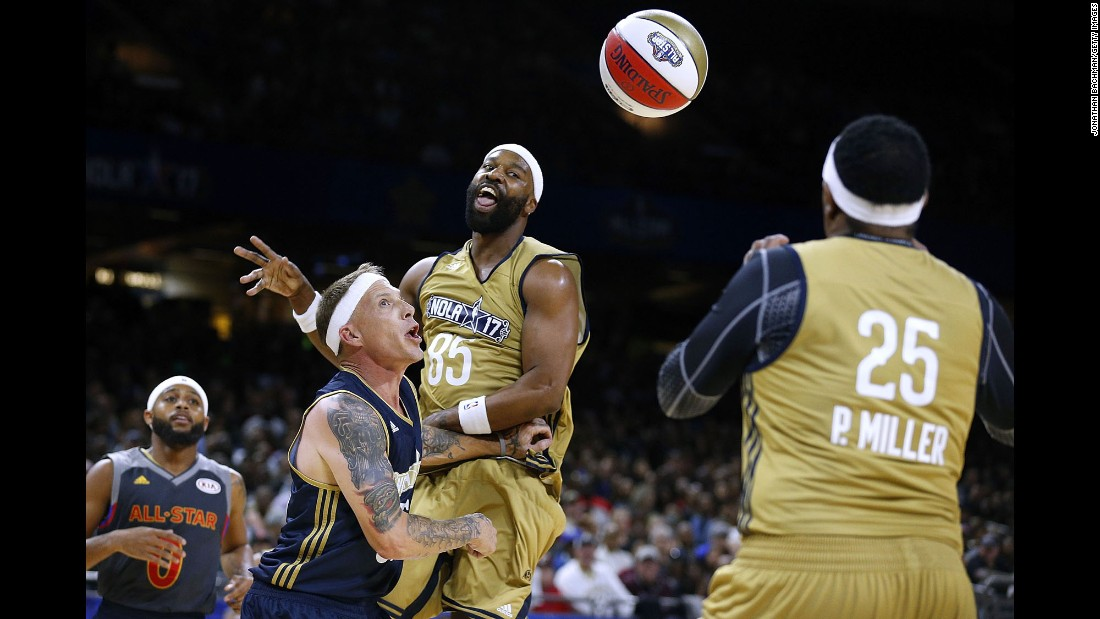 Former NBA star Baron Davis, center, passes to Percy Miller -- aka rapper Master P -- during the NBA All-Star Celebrity Game on Friday, February 17.