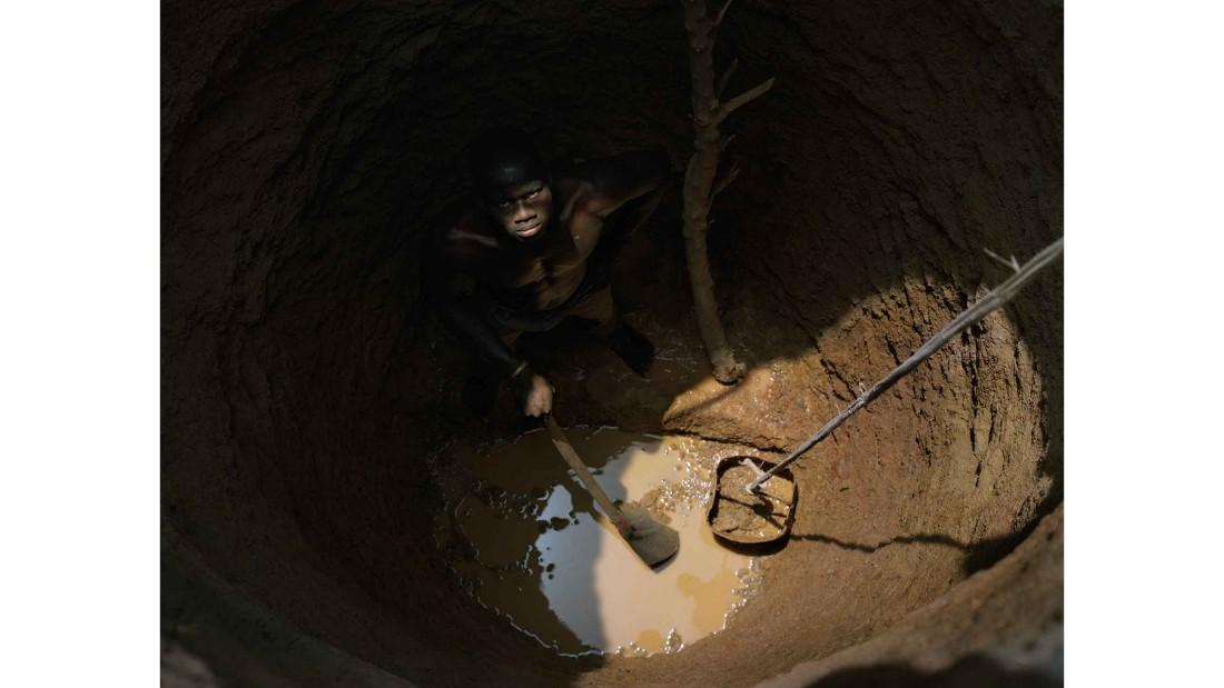 Zougmore Saidou, 21, digging a well at Gomtenga Village, Burkina Faso