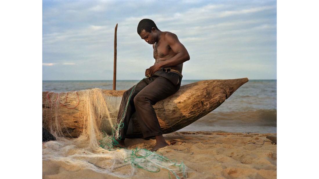 Fisherman Peter Chirwa, 45, prepares his nets in Ngosi Village, Malawi